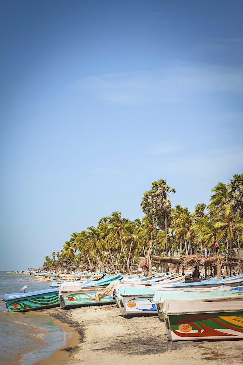 Travel News - Boats lined up on a sandy beach on Mannar Island.