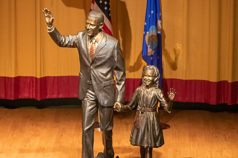 A bronze statue of former US president, Barack Obama, and his daughter Sasha.