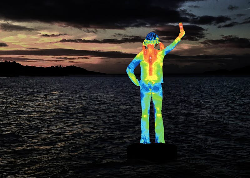 """""""5m Ocean Siren"""" is a solar-powered sculpture of an indigenous girl that changes colors as the water temperatures shift."""