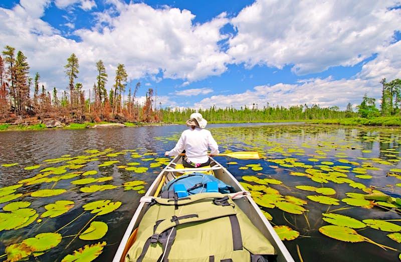 Canoer on Cross Bay Lake in the Boundary Waters