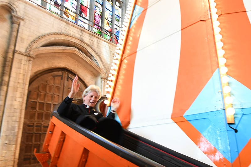 A member of the clergy on the helter-skelter at Norwich Cathedral