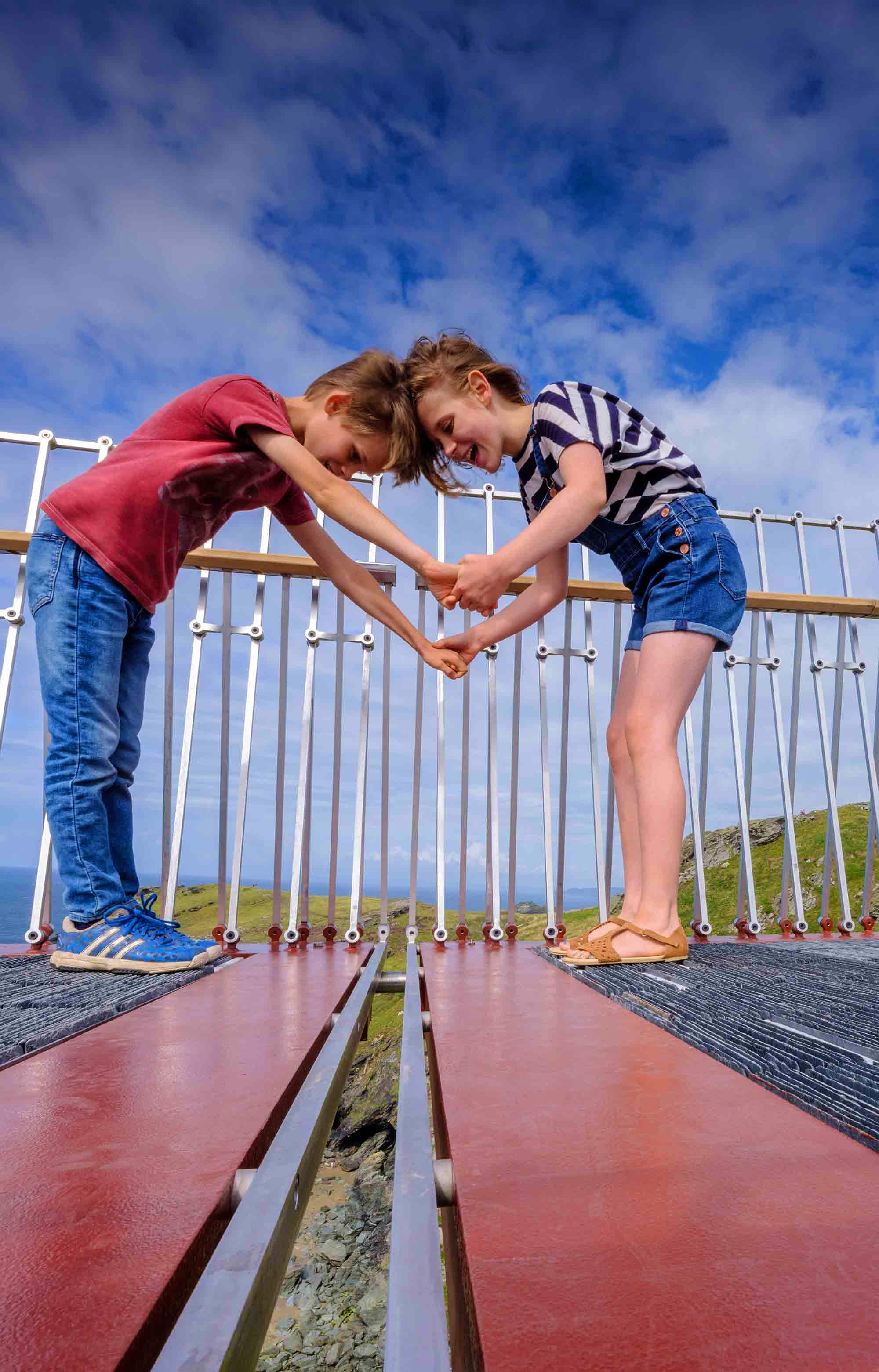 Children meet in the middle of the new bridge linking Tintagel Castle with the mainland