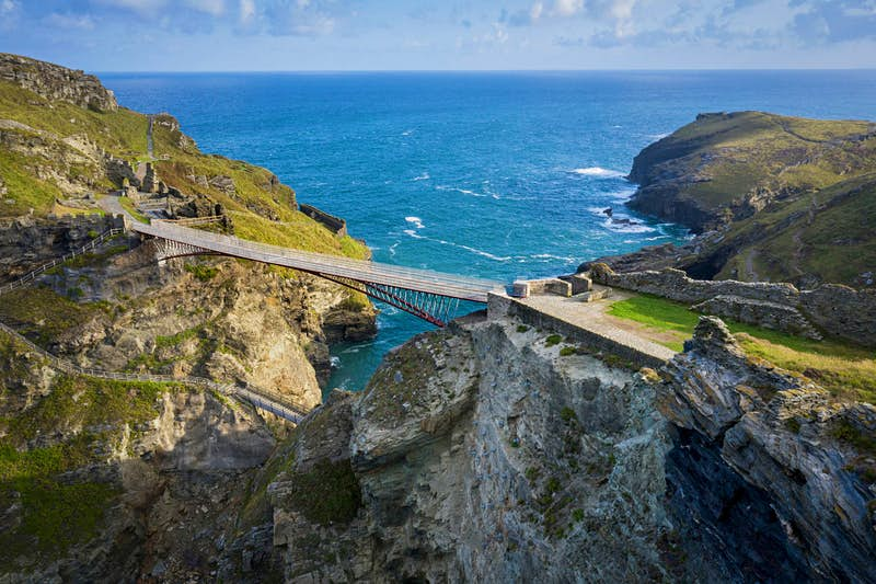 Walk across a dramatic new footbridge to visit the legendary birthplace of King Arthur
